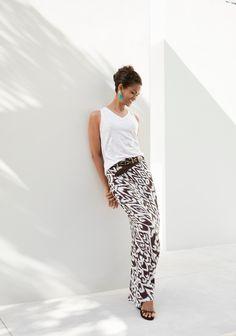 An exotic Ikat print tangos across this striking column maxi skirt.