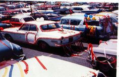 Cars are decorated for CASHS Color Day in this photo taken in 1964 in the school parking lot. - CASHS PHOTO
