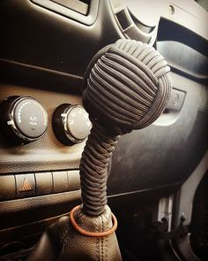 """The gear shift knob on my jeep broke, so I did this. I used a 2"""" wooden ball and about 20' of paracord.  #jeep #wrangler #gearshiftknob #paracord #monkeyfist"""
