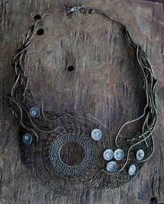 Necklace | Ksenia Vokhmentseva. 'Eloiza' Crocheted copper wire, discs and small crystal stones.