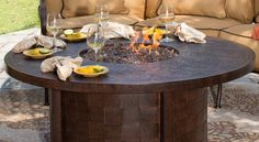 """Castelle 50"""" Round Fire Pit Coffee Table.  • 50""""W x 50""""D x 22""""H • Rust proof cast aluminum construction • Recommended for all collections • Fully Welded & artisan crafted • Hand finished and polished • Rich in detail • Weather resistant • Woven aluminum side panels"""