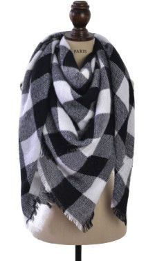 """Cozy up this fall and winter in a new arrival: The Buffalo Check Blanket Scarf in Navy and White. Wear it multiple ways to add a flare to your outfits. Details: - 100% Acrylic - Dimensions: 58x58"""" - C"""