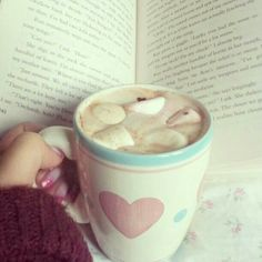 A mug of hot chocolate her favorite sweater and a good book was all she needed ~♡