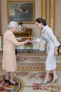 Celebrity guest: Actress Angelina Jolie is pictured being presented with the Insignia of an Honorary Dame Commander of the Most Distinguished Order of St Michael and St George by Queen Elizabeth II in the 1844 Room at Buckingham Palace on October 2014 Princesa Kate, Jolie Pitt, Le Jolie, Angelina Jolie Style, Angelina Joile, Ralph & Russo, Divas, Actrices Hollywood, Queen Of England