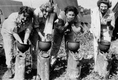 Nurses have a quick wash in their steel pots... Source: US National Archives http://med-dept.com/gallery/medical-personnel/
