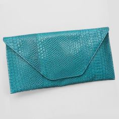 Large Snake Skin Print Envelope Blue Turquoise Clutch. Get the trendiest Clutch of the season! The Large Snake Skin Print Envelope Blue Turquoise Clutch is a top 10 member favorite on Tradesy. Save on yours before they are sold out!