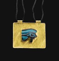 A LARGE EGYPTIAN FAIENCE WEDJAT-EYE AMULET LATE PERIOD, DYNASTY XXVI-XXX, 664-343 B.C.