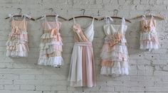flower girl dresses and a bridesmaids dress in pale pinks, pale peach, ivory, and cream by Armour sans Anguish #ecowedding #flowergirl