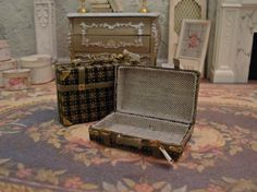 Are your mini dwellers jet setters who crave the next flight? If so, then let them travel in style with this two piece set of miniature luggage.