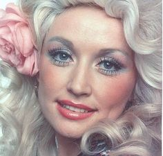 Dolly Parton wearing delicate pastels
