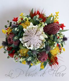 Mareeba- Australian native wedding bouquet. King protea, banksia, kangaroo paw, pin cushions, Geraldton wax, wattle, gumnuts, Aust. foliage.