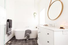 Small square grey floor tile l Freestanding bath l Hanging planter l Round mirror l Reno Rumble Week 5 Full House Reveal l Photos