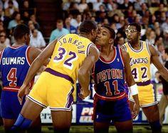 Magic Johnson and Isiah Thomas (Detroit Pistons)