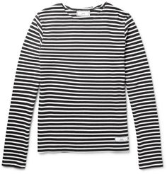 AMI's Breton T-shirt mirrors the design French sailors originally wore to make them easily spotted if they fell overboard. Cut from smooth cotton-jersey, this style is a seasonal staple that's been part of the Parisian wardrobe since its inception. Team yours with a peacoat, dark denim and a scarf.