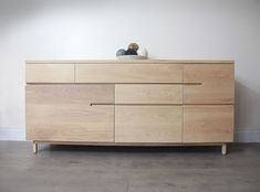 contemporary oak sideboard with four soft close, concealed runner drawers and two large cupboards with adjustable shelving