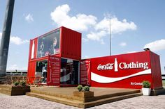 Pop-up clothing store constructed with shipping containers.. Eco-friendly & Branded