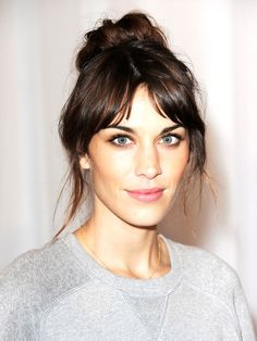 Alexa Chung's trademark center-parted fringe is not only effortlessly cool, it is also great trick for enlongating your face.