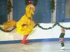 Does anything wanna make you sing Feliz Navidad more than watching Big Bird skate with this little girl?