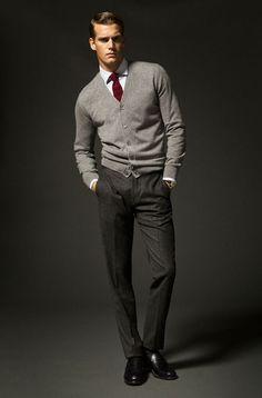 Shop this look on Lookastic:  http://lookastic.com/men/looks/dress-shirt-tie-cardigan-dress-pants-loafers/7988  — White Dress Shirt  — Burgundy Tie  — Grey Cardigan  — Black Vertical Striped Dress Pants  — Black Leather Loafers