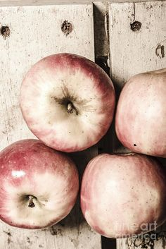 Shabby food top view on fruit in a farmers market crate. Antique apple by Ryan Jorgensen