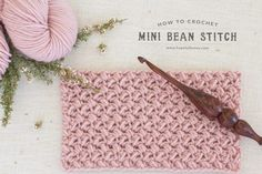 Crochet Tutorial Design How To: Crochet The Mini Bean Stitch - Easy Tutorial by Hopeful Honey - The Mini Bean Stitch creates a dense and tightly woven fabric, closely resembling adorable little beans. Perfect to use when crocheting snuggly scarves!