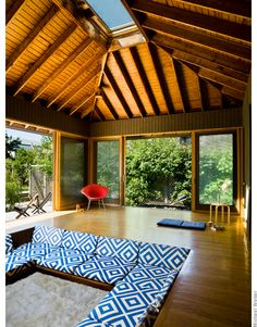 Yoga | Lounge | TV | Playroom | Gym .  Would love to convert a back house or barn into something like this!!