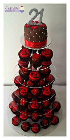 ... chocolate cutting cake with 6 dozen chocolate and red velvet cupcakes