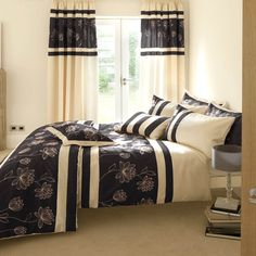 Inspirational bedroom with modern bed linen and curtains