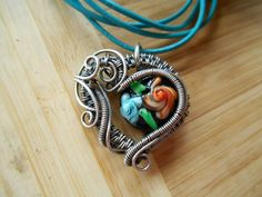 Sterling Silver Heart Pendant Lampwork Floral Bead Wire Wrapped and Oxidized on Turquoise color Leather cord