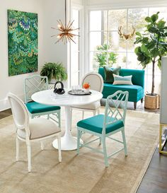 Use a vibrant shade of peacock on a banquette, dining chairs, and even in the art to add personality and punch!