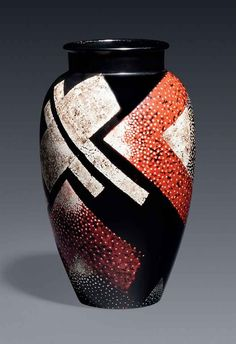 JEAN DUNAND (1877-1942) A VASE, CIRCA 1925 lacquered metal, inlaid with eggshell 8½ in. (21 cm.) high signed in lacquer Jean Dunand and numbered 5129