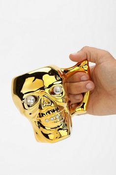 Gold skull mug. Nothing like sipping a hot cuppa joe out of a gilded skull. #urbanoutfitters