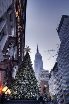 NYC - Holiday Season in Harold Square with Empire State looking on, New York City