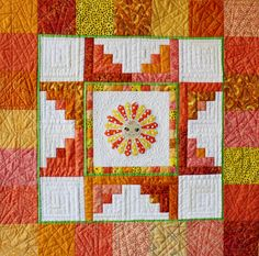 Sunshine quilt with Dresden center.  Pattern by Darcy Ashton.