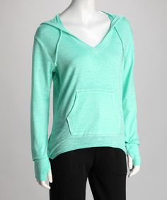 The best reward a busy mom can get is a stylish, comfortable top that can keep up. In a trendy acid wash tone, this hoodie features thumbholes at the cuffs and a generous amount of stretch.Measurements (size S): 25'' long from high point of shoulder to hem58% cotton / 37% polyester / 5% spandexHand wash; hang dryImported