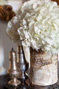 Wrap birch bark around a vase, tie with gold-glitter twine, and finish with a hydrangea bloom.