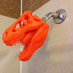 "Features:  -Attaches to any US standard shower head pipe.  -Children's shower ""head"" makes showering fun.  -Makes a great gift.  -Made in the USA.  --T-Rex says ""Get clean, or get eaten! Freeware!"" Ev"