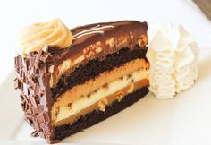Reese's® Peanut Butter Chocolate Cake Cheesecake: Chunks of Reese's® Peanut Butter Cups in our Original cheesecake with layers of delicious fudge cake and caramel.