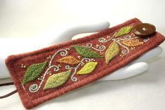 Hand Embroidery Embroidered Cuff Bracelet Jewelry Wool Falling leaves cuff in rust green. $72.00, via Etsy.