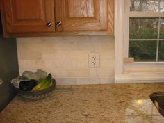 Travertine Backsplash With Bone White Cabinets Crema