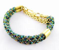 Peacock like colors ... I like the chain interwoven with the fibers.