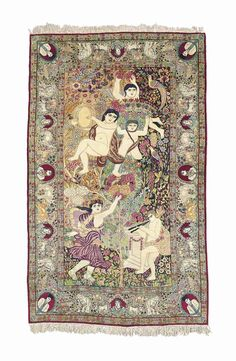 KIRMAN PICTORIAL RUG  SOUTH EAST PERSIA, CIRCA 1910  Depicting the mythological subject, 'La Danse d'une nymphe',    8ft.4in. x 5ft.2in. (254cm. x 157cm.)