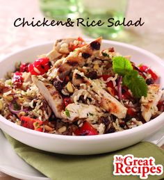 Toasted pine nuts add crunch to this colorful #hearty #salad of #chicken #bellpepper golden #raisins and basmati #rice