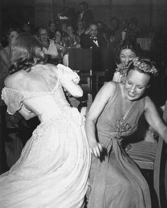 Bette Davis playing musical chairs at a Tailwagger party.