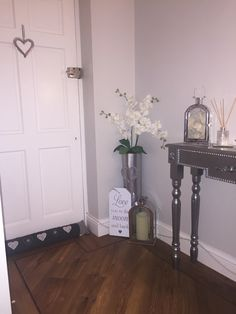 Tall floor vase,that's been spayed chrome with orchid arrangement. Chrome Lantern in different sizes. Adding some detail to an empty corner. karndean flooring.