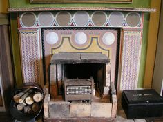 The fireplace in Clive Bell's study at Charleston, with mantelpiece decoration by Vanessa Bell Charleston Style, Charleston Homes, Images Of Fireplaces, Vanessa Bell, Bloomsbury Group, Hand Painted Furniture, Decoration, Home And Garden, Interior Design