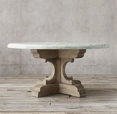 "RH's 17th C. French Bastide Oak & Marble Round Dining Table:Evoking the grandeur of 17th-century French Baroque design, our handcrafted dining table pairs a 2¼""-thick Carrara marble top with an ornate solid oak pedestal base."