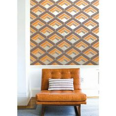 Geometric Retro Vintage Wallpaper. This stunning geometric wallpaper pulls out all the stops with its funky unique shapes and its metallic+glitter features. This retro wallpaper features a bright and unusual design that is sure to bring charisma and personality to your home. It has a bold colour scheme of orange, silver and grey. Click to shop for yours.