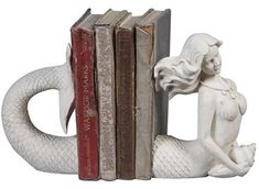 Price: $39.00 at shopplasticland.com This set of Victorian-inspired bookends takes me back to a time when gorgeous sirens wooed sailors to rocky shores, and when they decorated the ships themselves as figureheads. This mermaid is bookishly inclined, with little interest in adoring ships or haunting sailors.