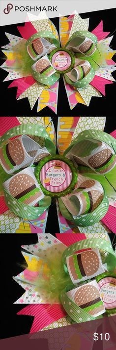 """Burger and Fries Hair Bow For the hamburger and fry loving girl! Cutest print ribbon! Burgers and fries. Center piece says 'I run on burgers and French fries'.  Bow measures approximately 6"""" across and is attached to a French barrette.  My bows are made with the highest quality ribbon and hardware. All ribbon ends are heat sealed.  All my bows are shipped in a small box to prevent any damage to the bows.  **Little ones must always be supervised while wearing the bow as small pieces may cause…"""